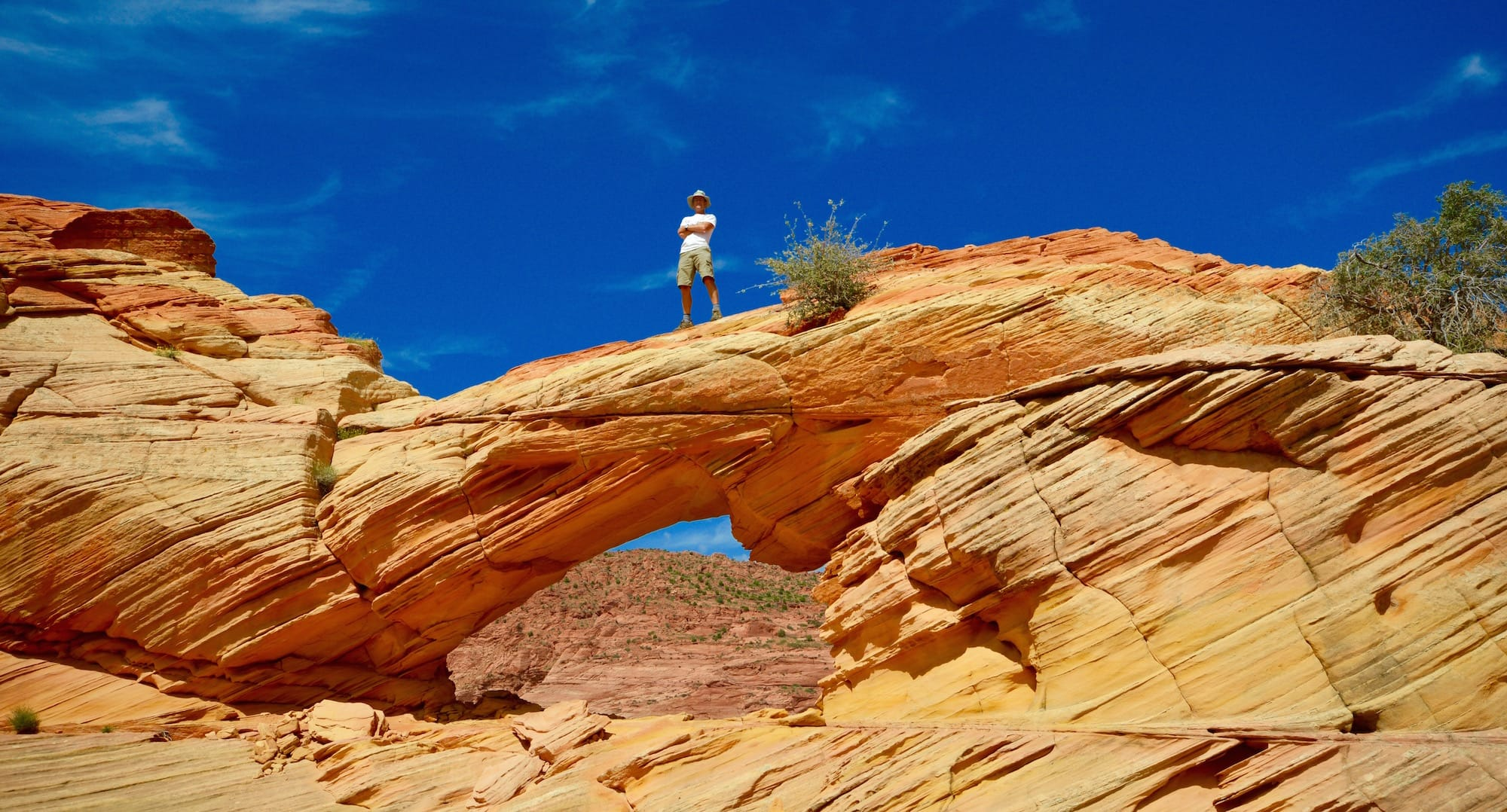 Man stands on Top Rock Arch, North Coyote Buttes
