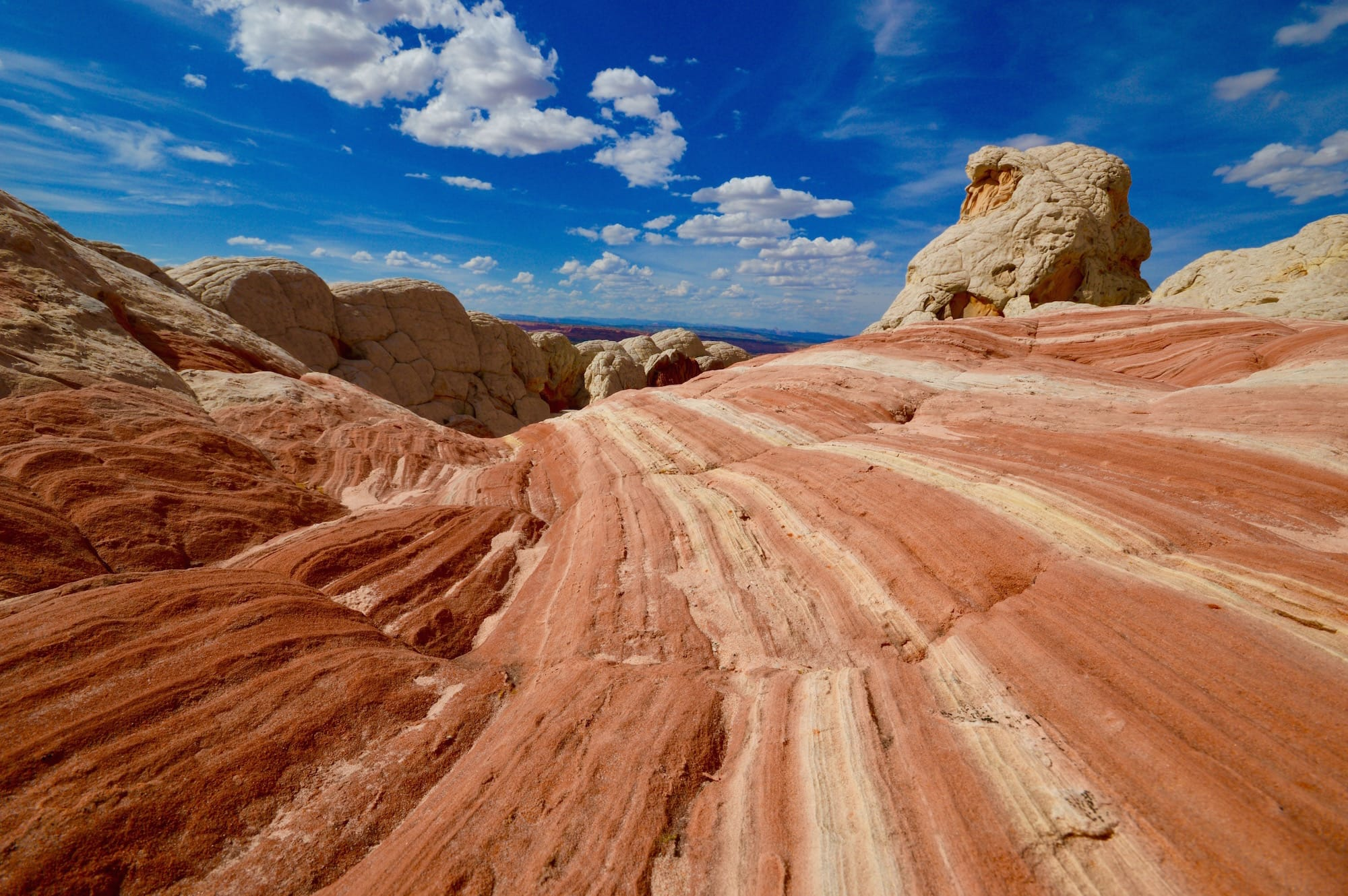 Striped rock with view of Vermilion Cliffs National Monument