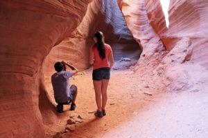 Couple photographs slot canyon