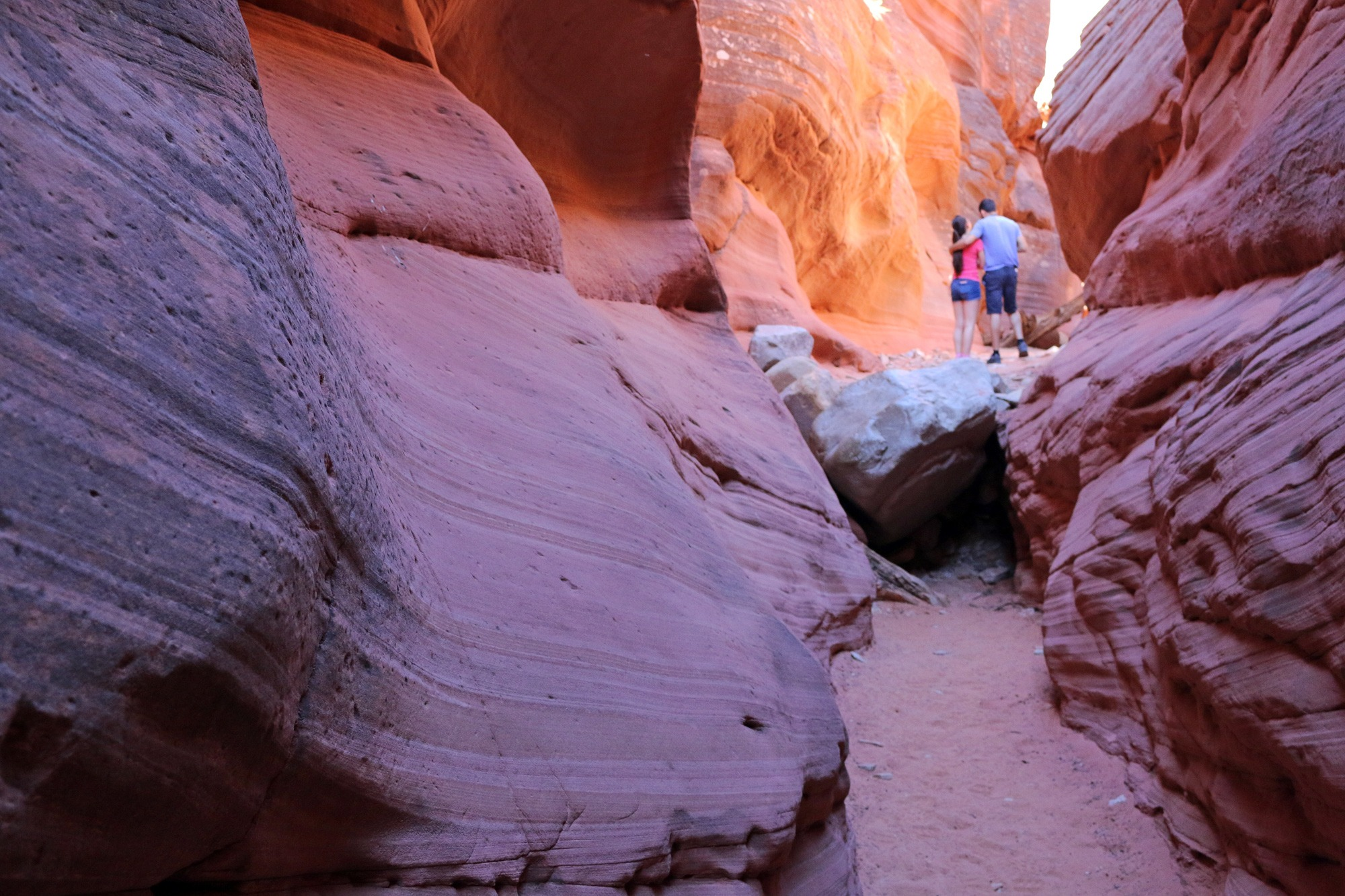 A couple enjoys a Peekaboo Slot Canyon Tour