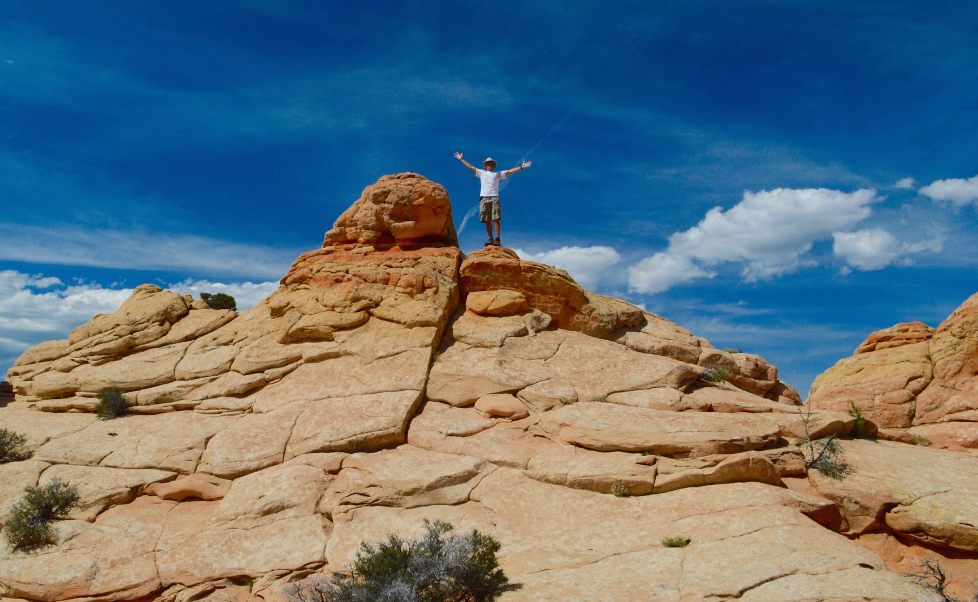 Man with outstretched arms at South Coyote Buttes