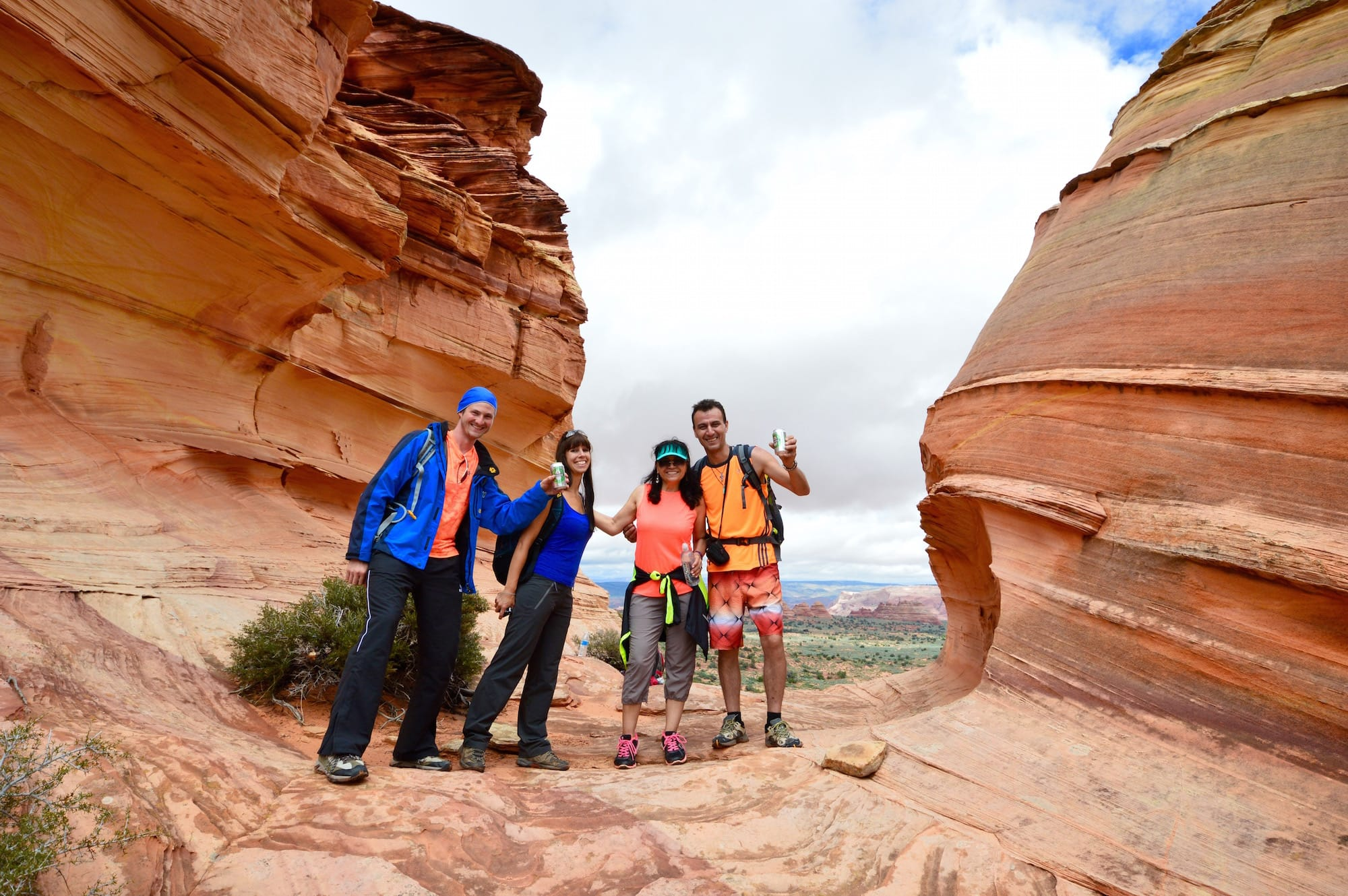 Tour guests post at South Coyote Buttes