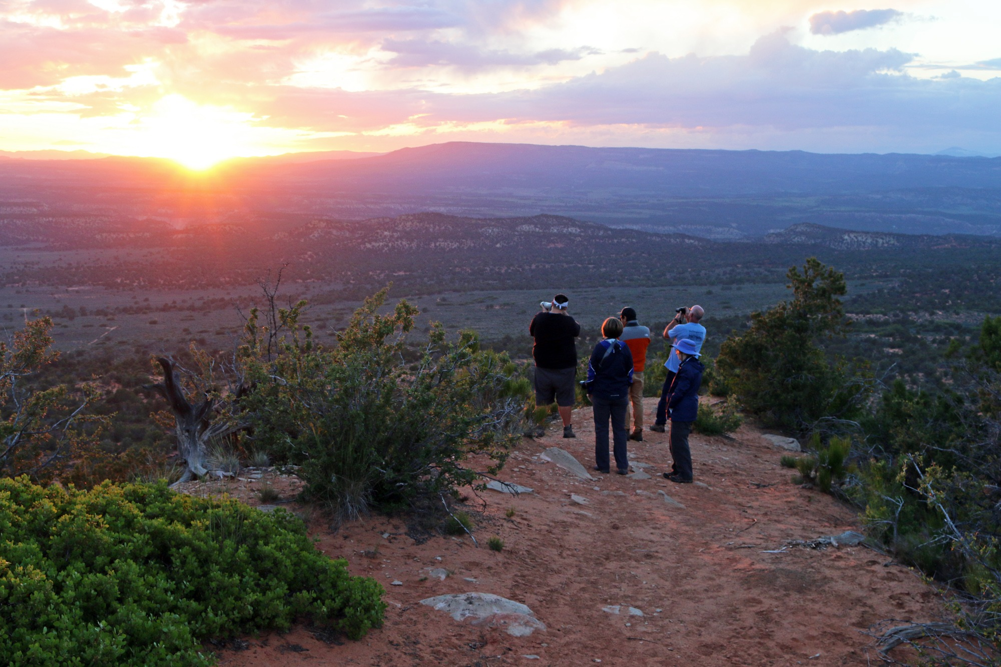 Photographers watch the sun set from Red Knoll