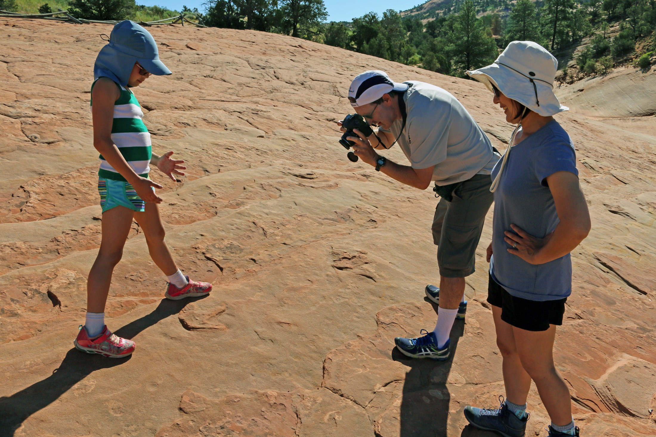 Family photographs dinosaur tracks