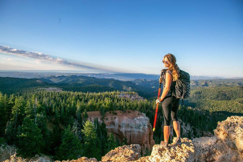 Female hiker at on Colorado Plateau trail near Kanab UT